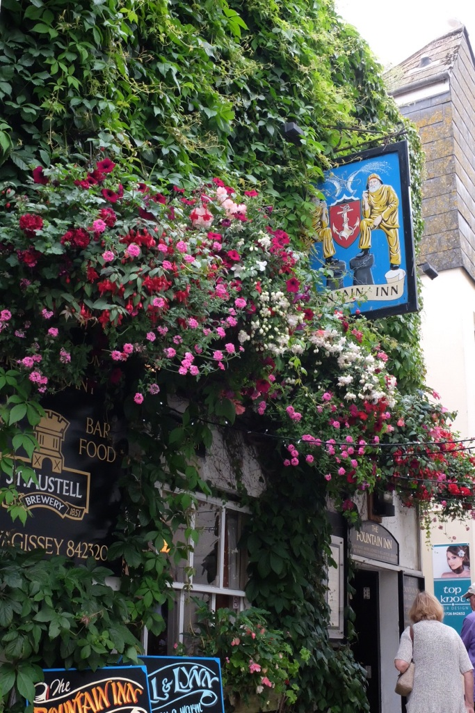 We love the flowers - in this case adorning a public house in Mevagissey.