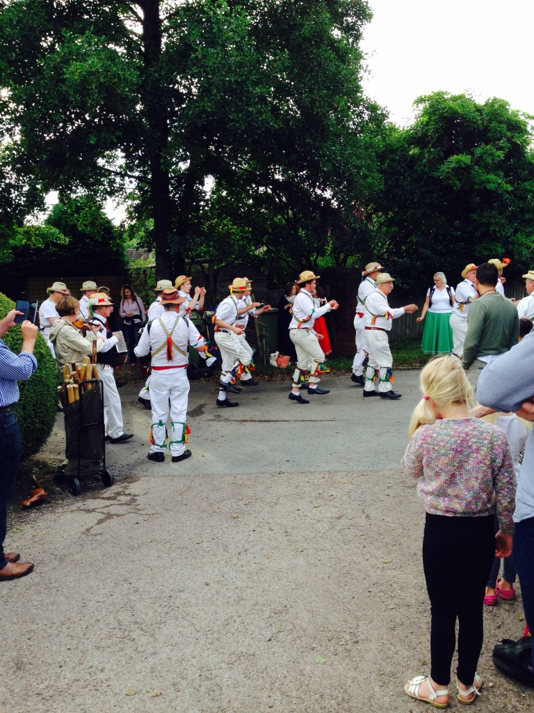 The Morris Dancers in action on the road outside the pub