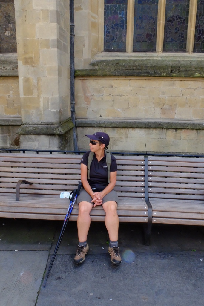 Ruth looking much shorter at the last seat on the trail, outside the Bath Abbey