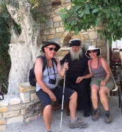The Priest who kindly offered us biscuits and Raki on our trip down the gorge. He put his hat on for the photo.