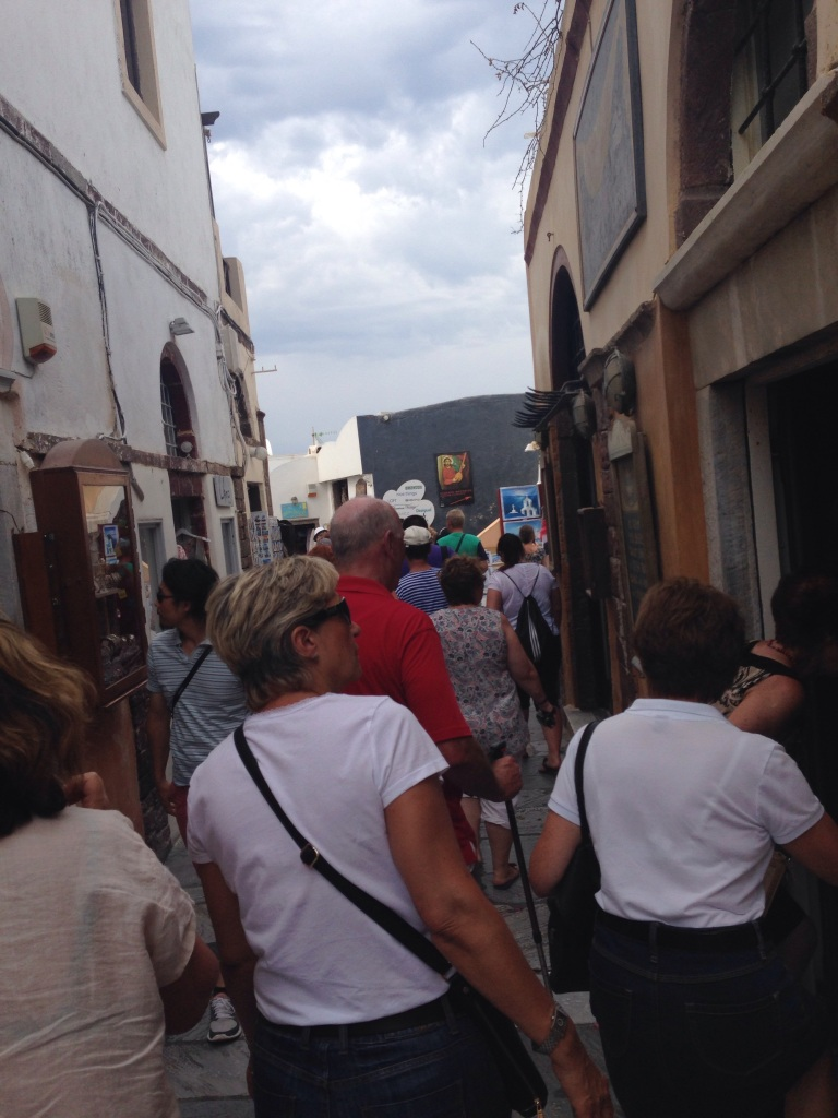 The main drag in Oio at peak hour when the cruise ships have disgorged their passenger onshore.