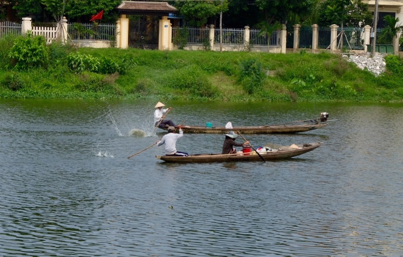 These people appeared to be fishing by beating the water, presumably to stun any fish, this was on one of the old imperial city canals in Hue