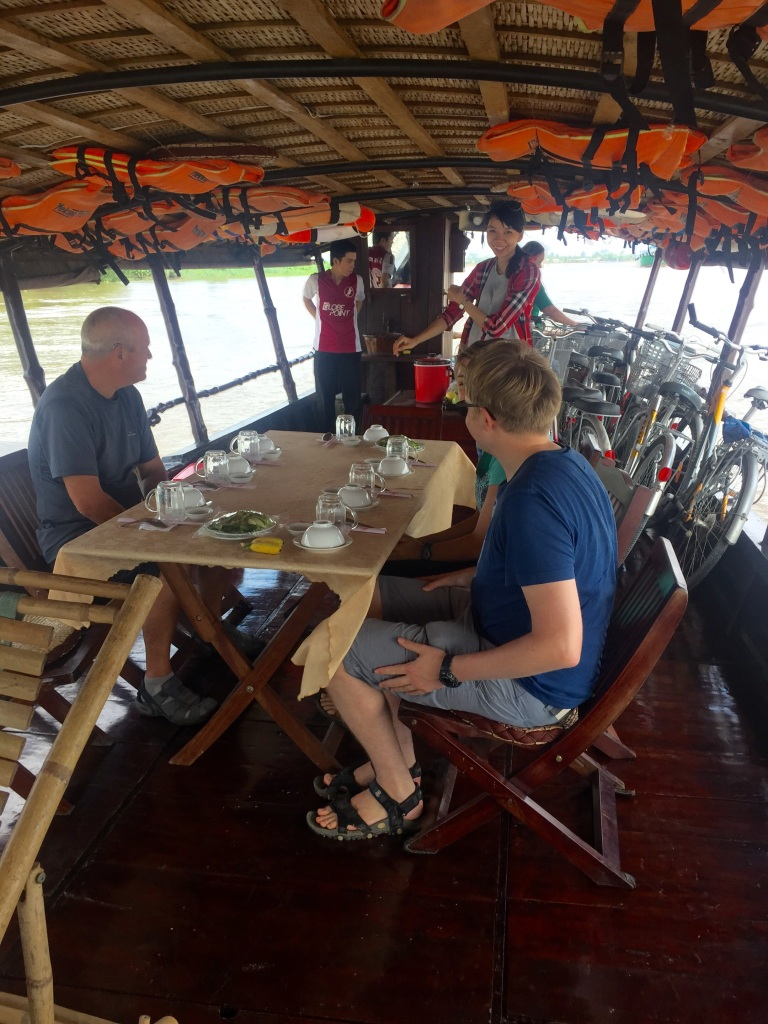 We enjoyed a very pleasant lunch cooked on the boat while we motored up a small channel on the Mekong