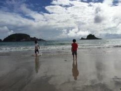 Boys at the beach, Hahei, NZ