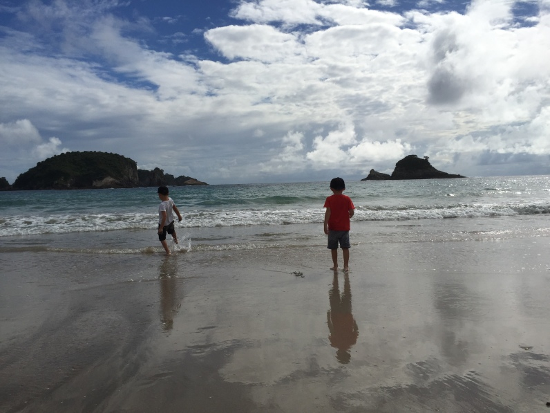 Boys at the beach, Hahei, NZ