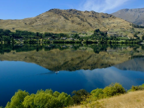 A paddle boarder breaks the reflection - Lake Hayes, NZ