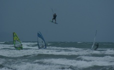 High flying kite surfer as Cyclone approaches. Orewa NZ