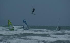 High flying kite surfer as Cyclone approaches. Orewa NZ