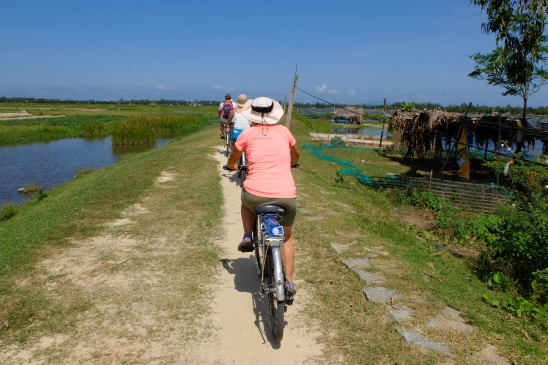 We rode along enbankments, through rice paddies, bush, along dusty roads